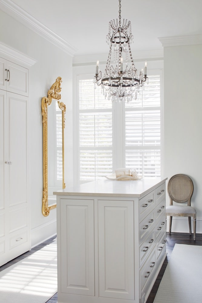 White closet with a gold mirror on the wall shot by Richard Leo Johnson
