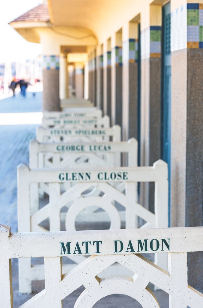 In Deauville, barriers outside the beach huts on Les Planches bear the names of famous filmmakers and actors.