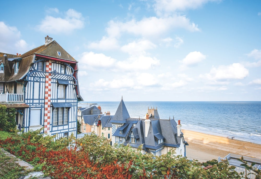 The morning light on the beach and homes of Trouville makes it obvious why the town is a perfect vacation destination.