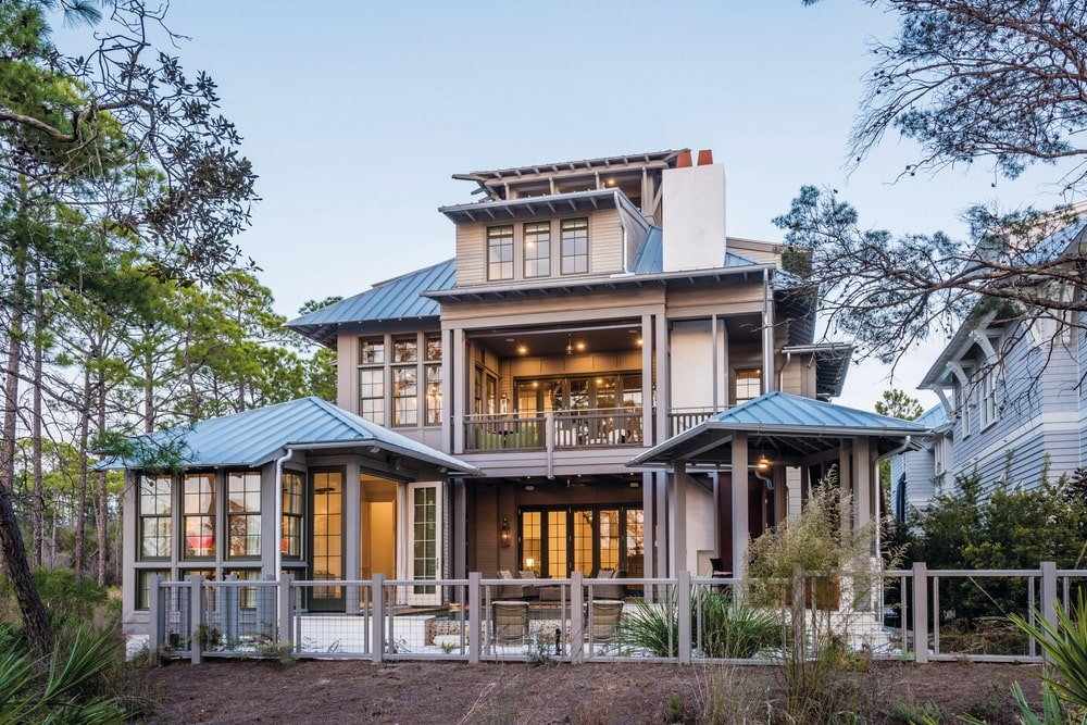 This rustic yet modern home in the coastal community of WaterColor off Scenic Highway 30-A features custom millwork by E. F. San Juan on all doors, windows, interior and exterior details, and the stunning staircase created by Arcways. | Photo by Kurt Lischka
