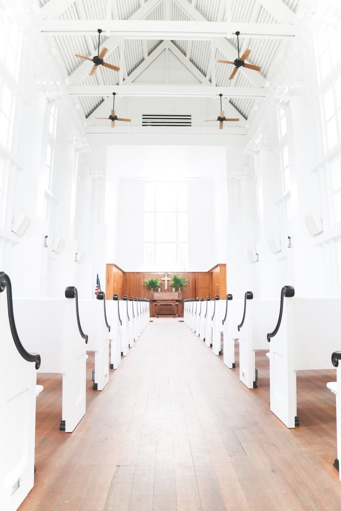 The Chapel at Seaside, one of the New Urbanist town's most iconic structures, features E. F. San Juan custom millwork beams, bell tower, and other details. | Photo by Brenna Kneiss
