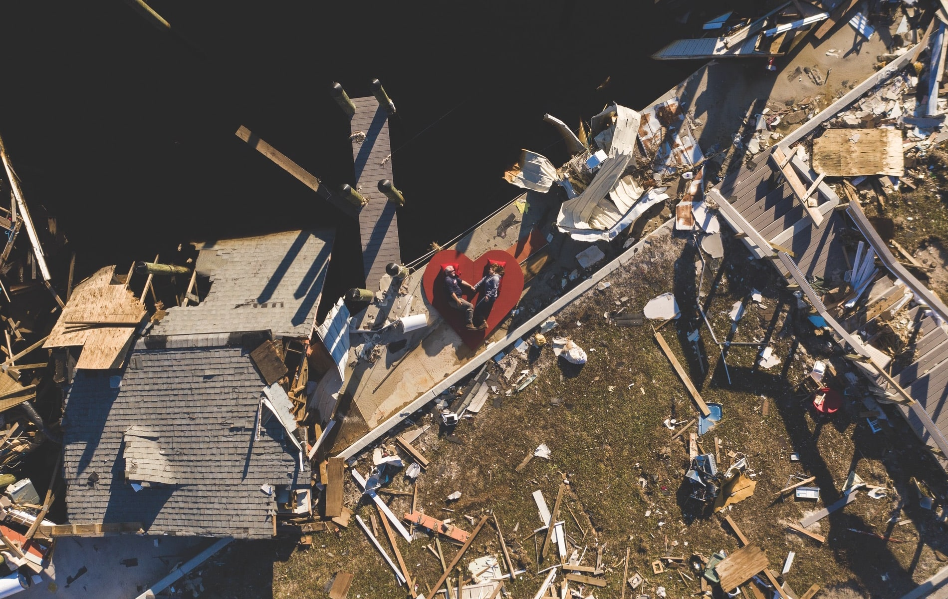 Owners Kevin and Cyndi Lanier of KCSportfishing lie amid the wreckage in Mexico Beach, Florida, as part of the Never Forgotten Coast campaign. In the wake of Hurricane Michael, the Laniers plan to rebuild their lives and their business alongside their neighbors.