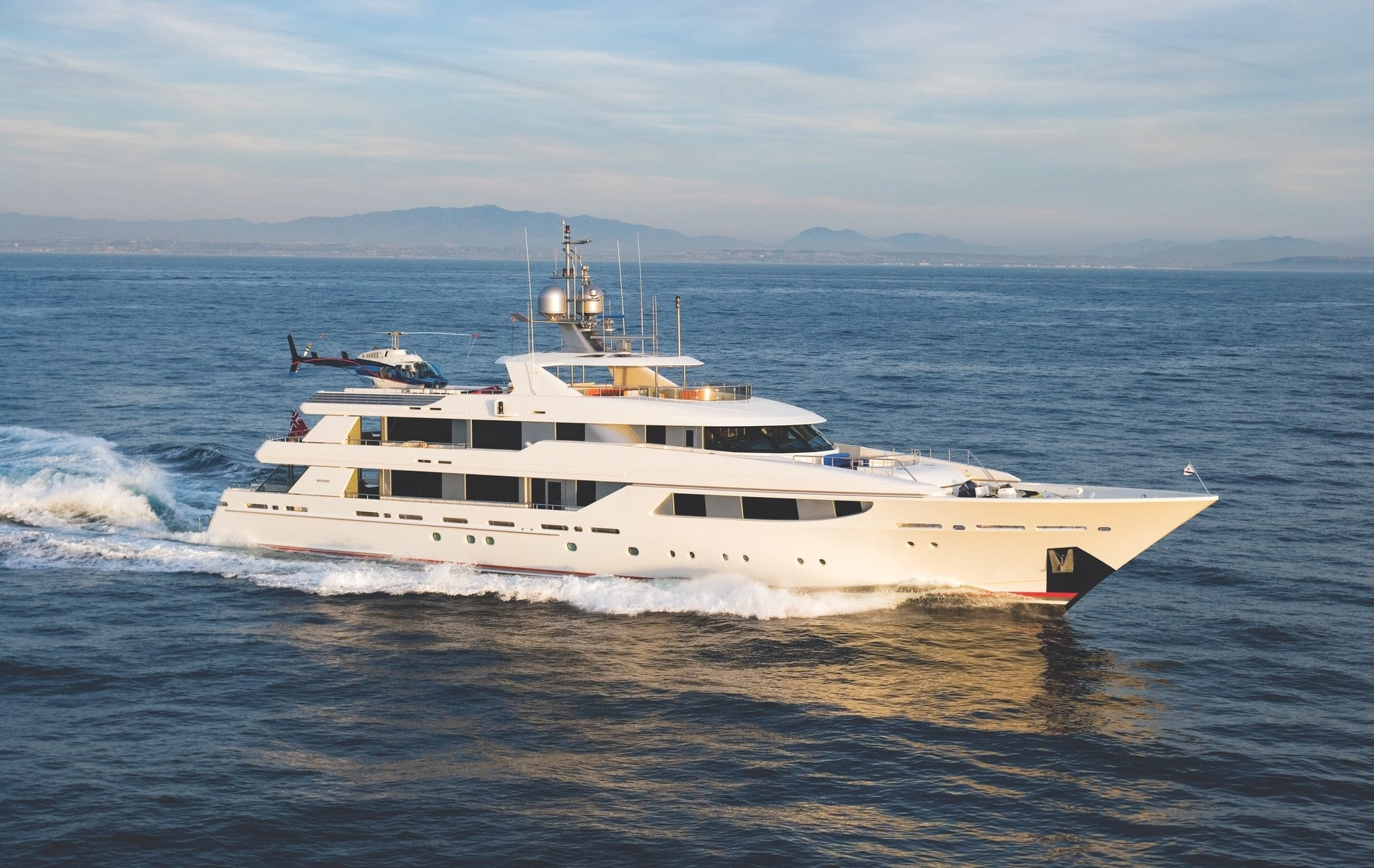 The Westport 164-foot (50m) Tri-Deck Motoryacht boasts six staterooms, including a top-deck VIP suite with its own sun deck, plus a large formal dining room, a commercial-grade galley, and much more.