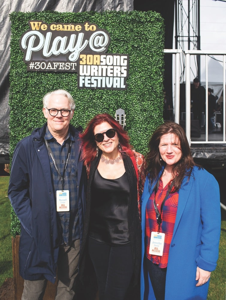 Russell Carter, Rosanne Cash, and Jennifer Steele hang out in the artist lounge at Grand Boulevard's main stage during 30A Songwriters Festival