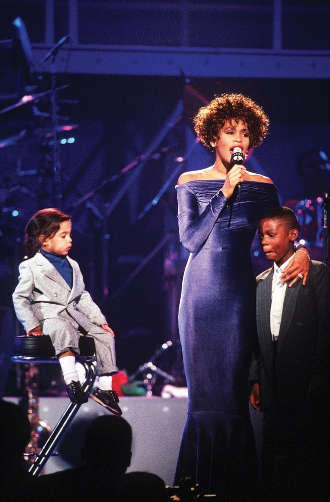 Whitney Houston performing at HBO's Welcome Home Heroes event in 1991. Photo by Mark Kettenhofen / DefenseImagery