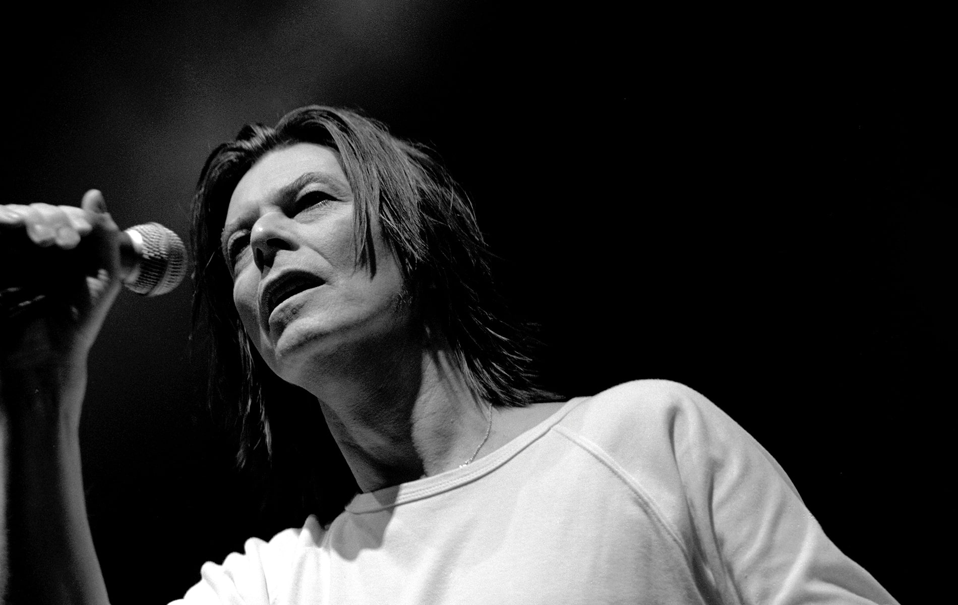 Black and White close up shot of David Bowie performing in Milan in 1999