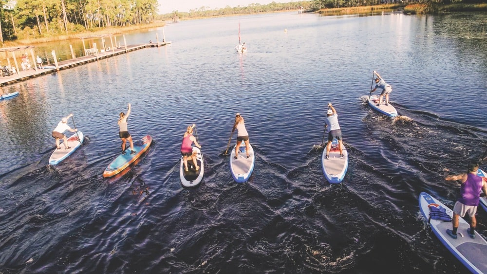 Local athletes paddle across Western Lake for a run through Grayton Beach State Park at Fit For Hope's pop-up event with RUN/SUP. | Photo courtesy of Fit For Hope