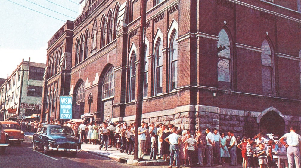 A vintage shot of the Grand Ole Opry at Ryman Auditorium with a crowd lined up to get in | Photo courtesy of Nashville Convention & Visitors Corp.