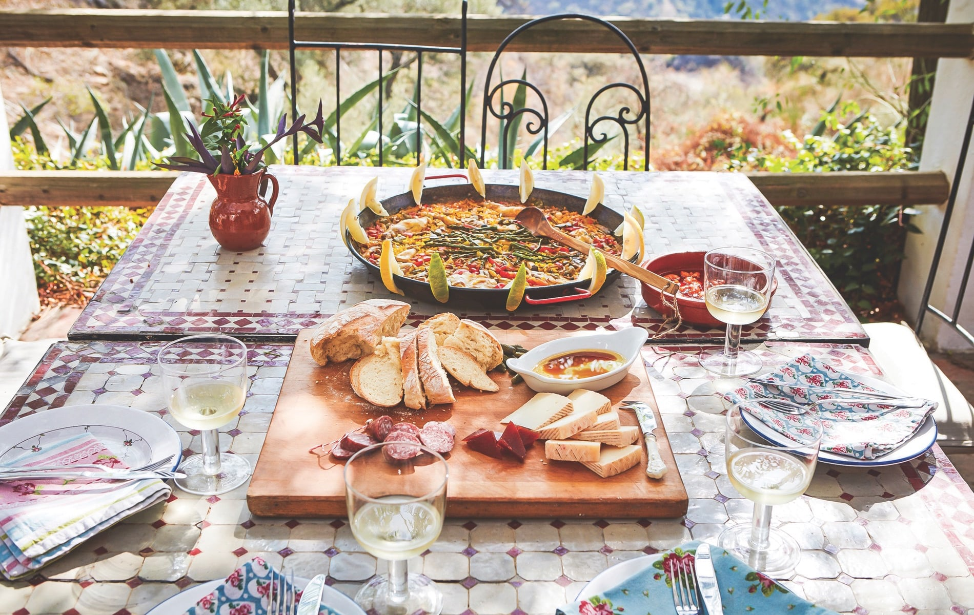 A seafood paella preceded by cheese, charcuterie, and bread with good olive oil is the quintessential Spanish celebration feast.