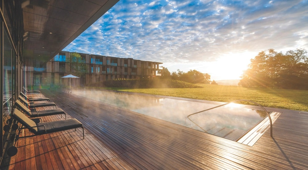 Germany's Lanserhof Tegernsee resort offers chic accommodations, a saltwater pool, a medical spa, and a golf course. | Photo courtesy of Lanserhof Tegernsee