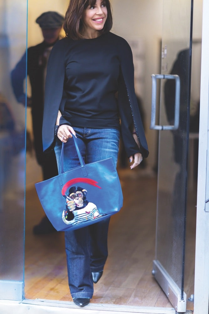 Anna Cortina with tote bag featuring art by Philippe Boonen