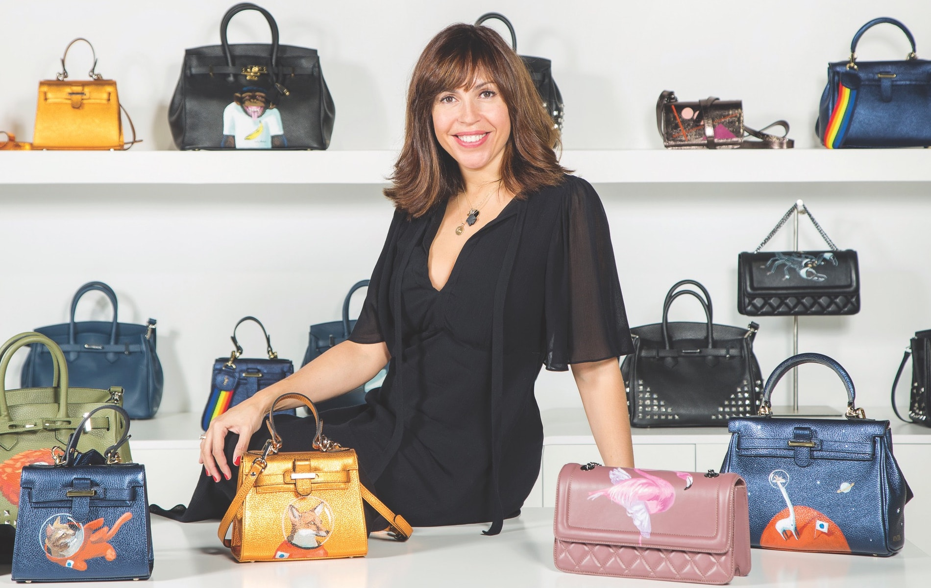 Designer Anna Cortina's eponymous brand partners with world-renowned artists to create fun handbags and other accessories that celebrate the joy of life.