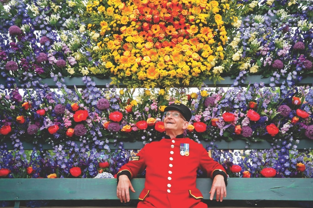 Chelsea Pensioner Paul Whittick enjoys the display at the Marks & Spencer Floral Market exhibition during press day at the RHS Chelsea Flower Show 2018.