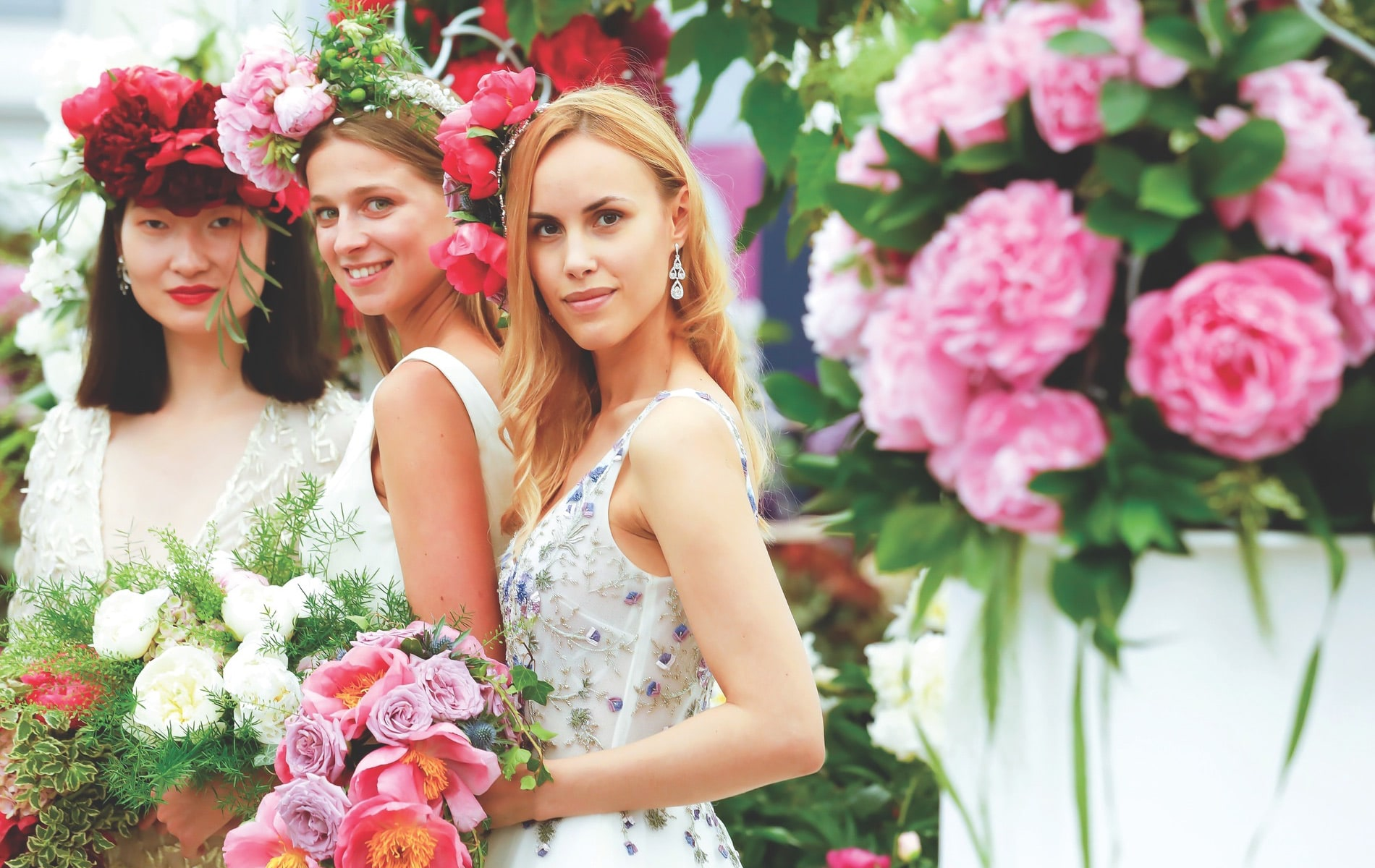 Models wear bridal designs by Alan Hannah for Primrose Hall Nursery's Love & Romance exhibition during press day at the RHS Chelsea Flower Show 2018 in London.