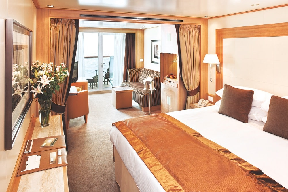 Seabourn's Veranda suites feature a living area, a queen-size bed or two twin beds, full-length windows and a glass door to a private veranda, and more. | Photo courtesy of Seabourn