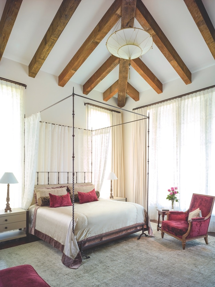 Gregorius Pineo's custom seventeenth-century Italian iron bed is the focal piece of the master bedroom, A Boheme Design, A Boheme
