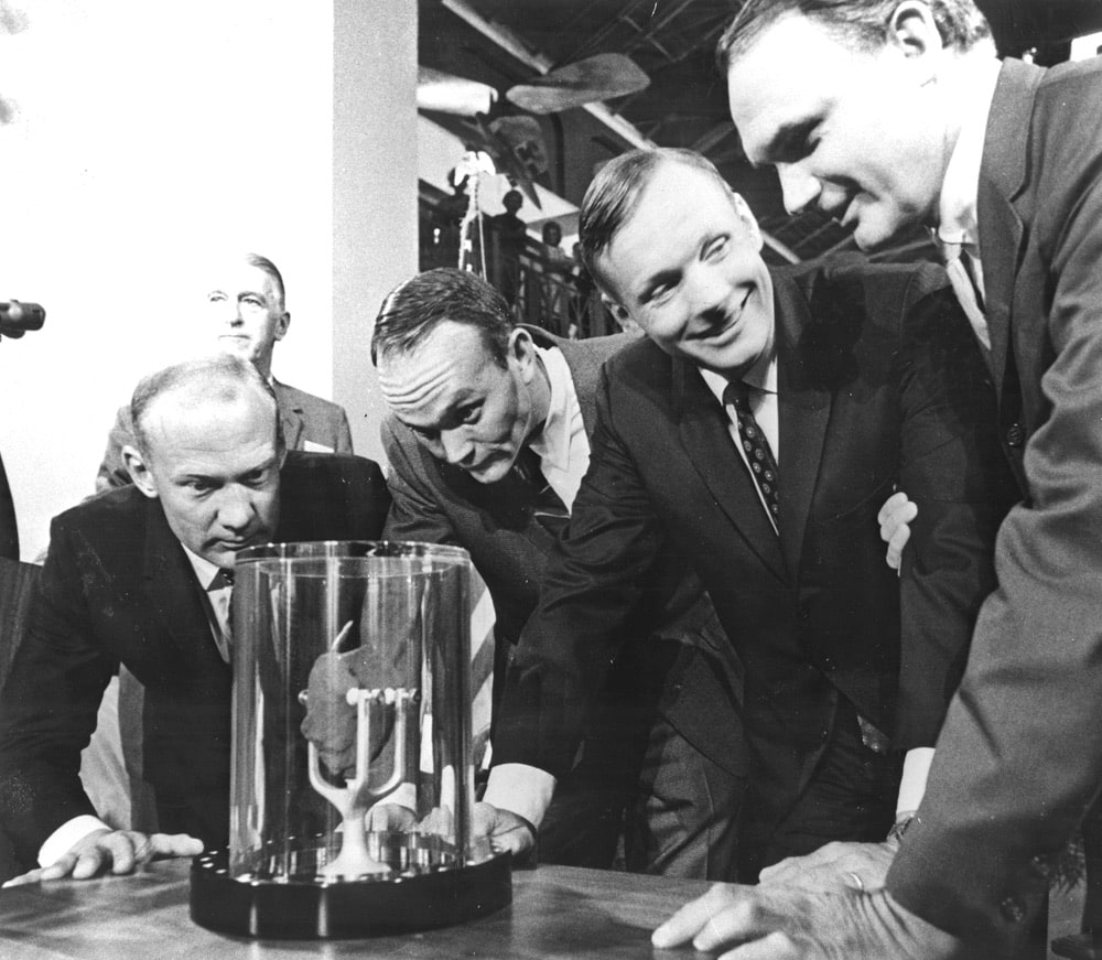 Apollo 11 astronauts, (left to right) Edwin E. Aldrin Jr., Lunar Module pilot; Michael Collins, Command Module pilot; and Neil A. Armstrong, commander, are showing a two-pound Moon rock to Frank Taylor, director of the Smithsonian Institute in Washington D.C. The rock was picked up from the Moon's surface during the Extra Vehicular Activity (EVA) of Aldrin and Armstrong following man's first Moon landing and was was presented to the Institute for display in the Art and Industries Building. The Apollo 11 mission, launched from the Kennedy Space Center, Florida via the Marshall Space Flight Center (MSFC) developed Saturn V launch vehicle on July 16, 1969 and safely returned to Earth on July 24, 1969. With the success of Apollo 11, the national objective to land men on the Moon and return them safely to Earth had been accomplished.Apollo 11 astronauts, (left to right) Edwin E. Aldrin Jr., Lunar Module pilot; Michael Collins, Command Module pilot; and Neil A. Armstrong, commander, are showing a two-pound Moon rock to Frank Taylor, director of the Smithsonian Institute in Washington D.C. The rock was picked up from the Moon's surface during the Extra Vehicular Activity (EVA) of Aldrin and Armstrong following man's first Moon landing and was was presented to the Institute for display in the Art and Industries Building. The Apollo 11 mission, launched from the Kennedy Space Center, Florida via the Marshall Space Flight Center (MSFC) developed Saturn V launch vehicle on July 16, 1969 and safely returned to Earth on July 24, 1969. With the success of Apollo 11, the national objective to land men on the Moon and return them safely to Earth had been accomplished. nasa, apollo 11 50th anniversary