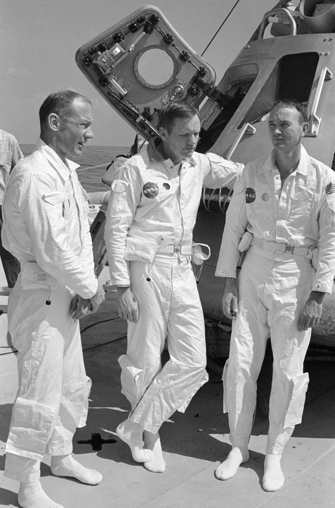 The prime crew of the Apollo 11 lunar landing mission relaxes on the deck of the NASA Motor Vessel Retriever prior to participating in water egress training in the Gulf of Mexico. Left to right, are astronauts Edwin E. Aldrin Jr., lunar module pilot; Neil A. Armstrong, commander; and Michael Collins, command module pilot. In the background is Apollo Boilerplate 1102 which was used in the training exercise. nasa, apollo 11 50th anniversary