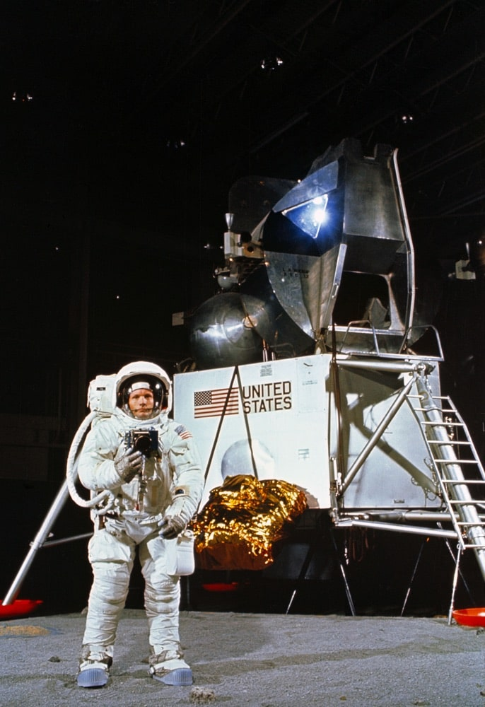 Astronaut Neil A. Armstrong, wearing an Extravehicular Mobility Unit, participates in a simulation of deploying and using lunar tools on the surface of the moon during a training exercise in Building 9 on April 22, 1969. Armstrong is the commander of the Apollo 11 lunar landing mission. In the background is a Lunar Module mock-up. nasa, apollo 11 50th anniversary