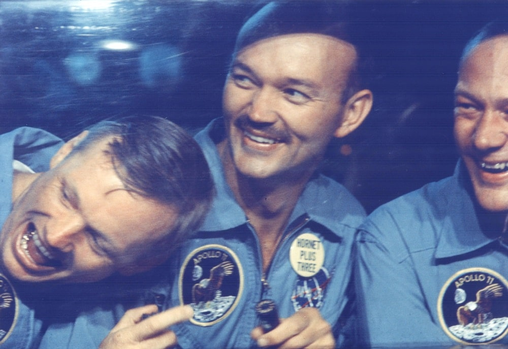 The Apollo 11 astronauts, left to right, Neil A. Armstrong, Michael Collins and Edwin E. Aldrin Jr. share jokes with well-wishers on the other side of the window of their Mobile Quarantine Facility aboard the USS Hornet. The astronauts splashed down at 12:50 p.m. EDT at the completion of their historical eight-day first manned lunar landing. nasa, apollo 11 50th anniversary
