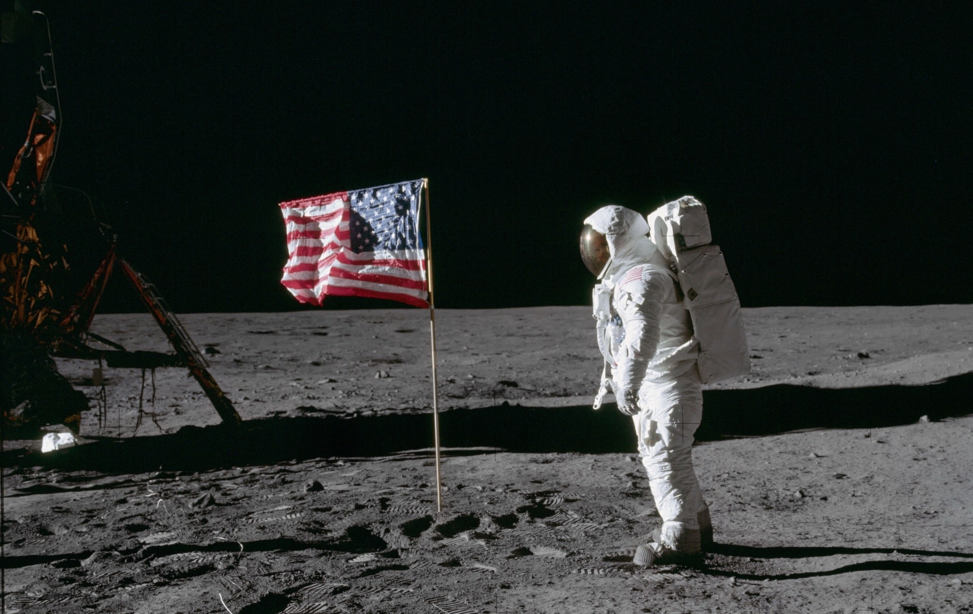 "Astronaut Edwin E. Aldrin Jr., lunar module pilot of the first lunar landing mission, poses for a photograph beside the deployed United States flag during Apollo 11 extravehicular activity (EVA) on the lunar surface. The Lunar Module (LM) is on the left, and the footprints of the astronauts are clearly visible in the soil of the moon. Astronaut Neil A. Armstrong, commander, took this picture with a 70mm Hasselblad lunar surface camera. While astronauts Armstrong and Aldrin descended in the LM the ""Eagle"" to explore the Sea of Tranquility region of the moon, astronaut Michael Collins, command module pilot, remained with the Command and Service Modules (CSM) ""Columbia"" in lunar orbit. nasa, apollo 11 50th anniversary"