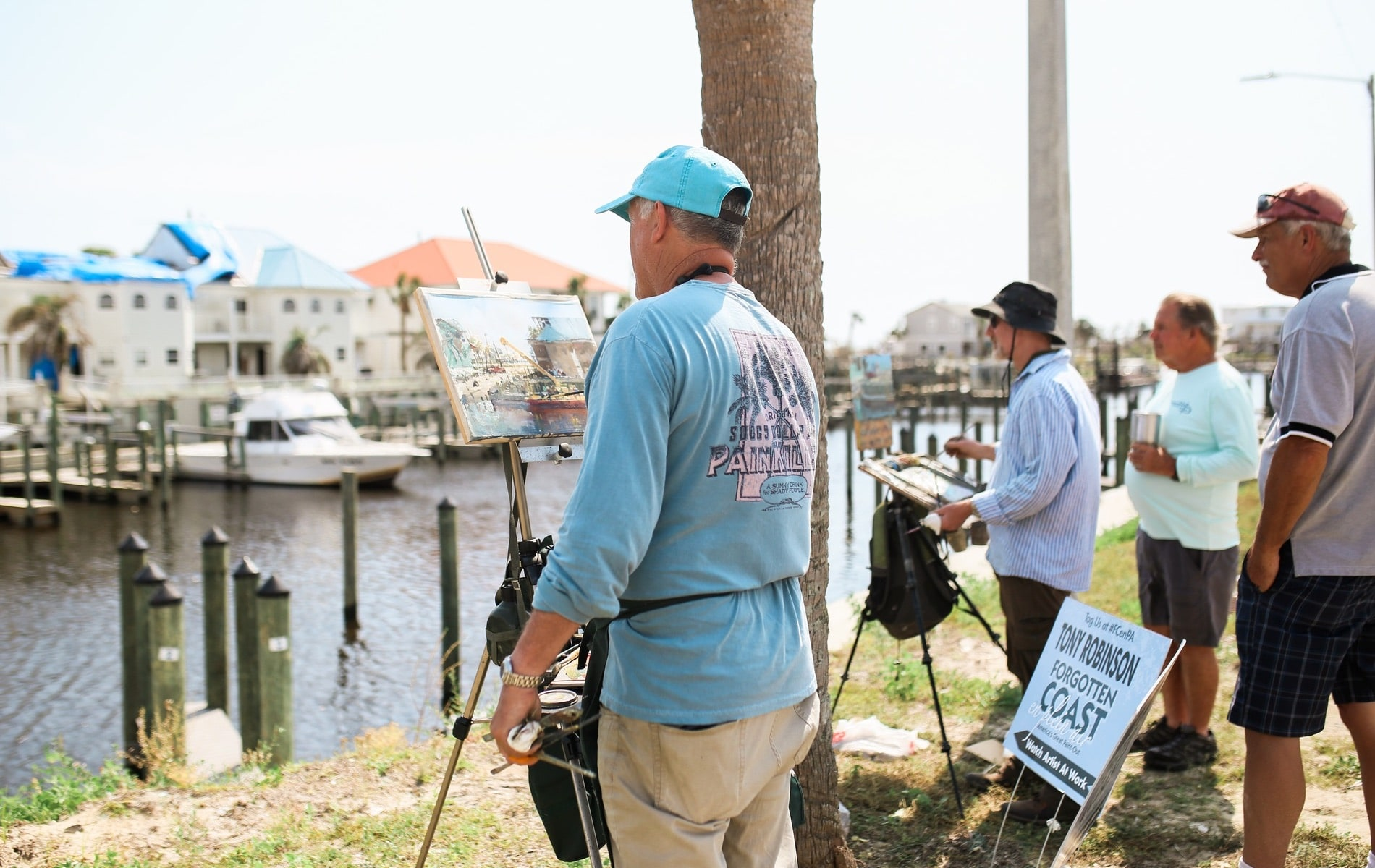 Stewart White of Baltimore and Tony Robinson of Wexford, Ireland, paint the scene at the Mexico Beach Canal.