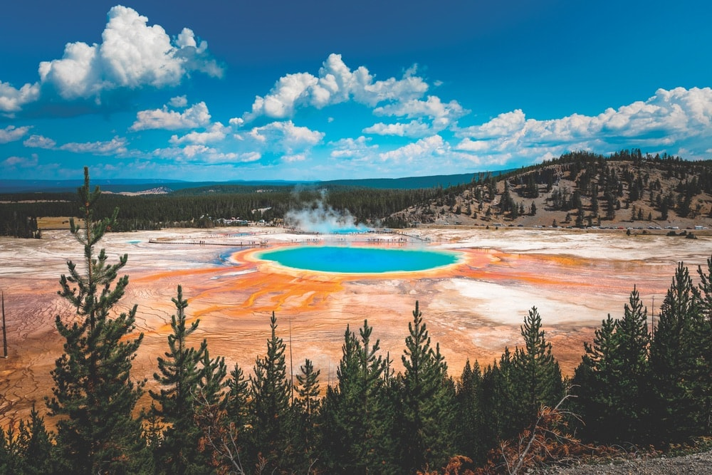 While the microbial mats and chemicals that create the rainbow explosion of color in this natural phenomenon might be complicated to some, its intriguing beauty can be appreciated by all. The Grand Prismatic Spring in Wyoming's Yellowstone National Park discharges about 560 gallons of hot water per minute.