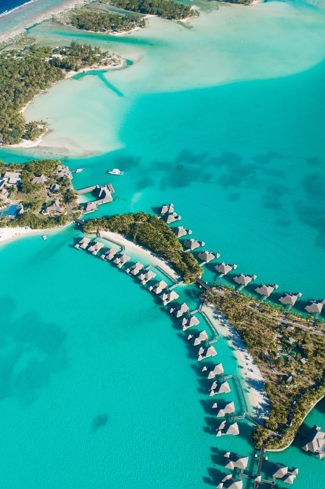 Aerial view of green water and bungalows, Bora Bora French Polynesia