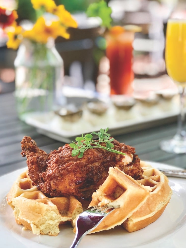 Chef Shelley Cooper whips up incredible country favorites, such as chicken and waffles, at Dancing Bear Lodge and Appalachian Bistro near Townsend, Tennessee. | Photo courtesy of Dancing Bear Lodge