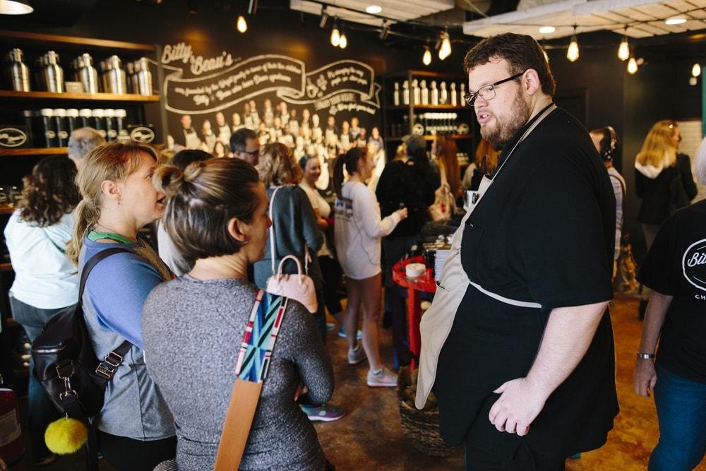 Employee talking to customers of Bitty & Beau's in Charleston