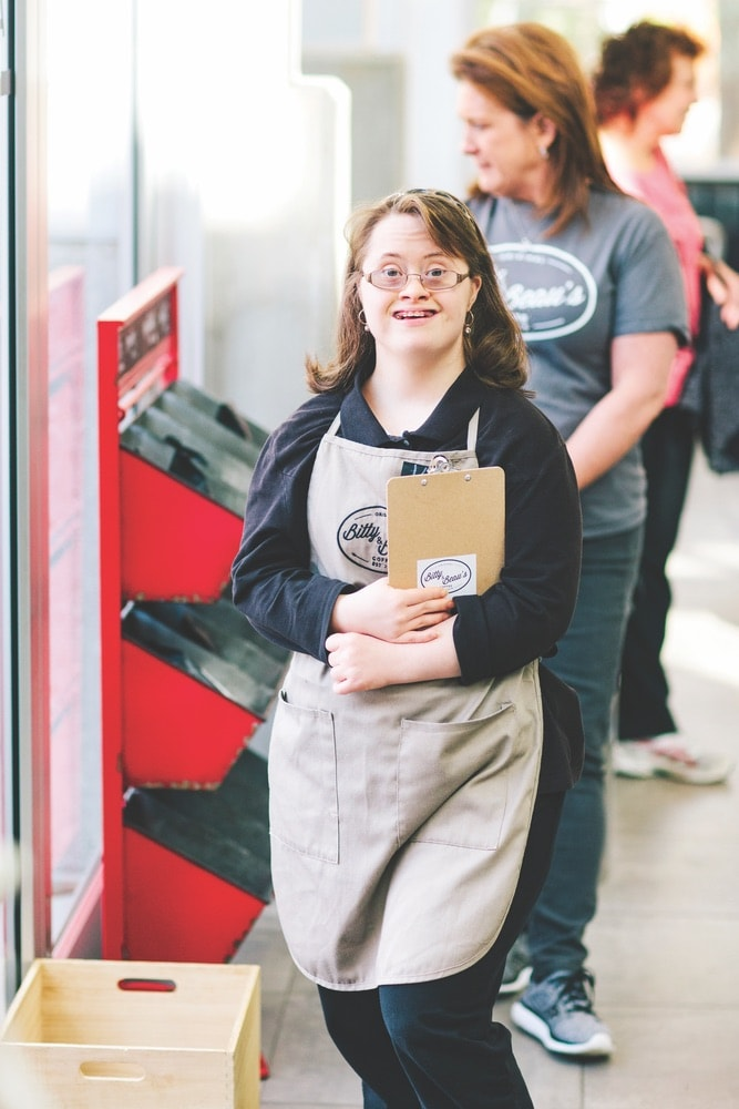 Katie Zeigler, an employee at Bitty & Beau's in Wilmington holding a clip board.