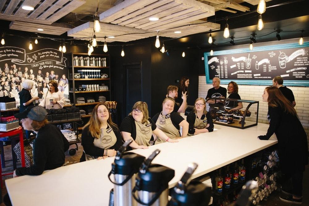 A few employees of Bitty & Beau's Coffee's Charleston location talking.