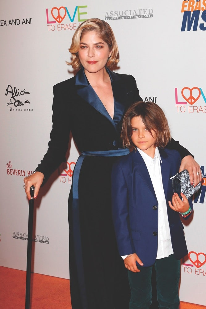 Selma Blair and her son, Arthur, walk the orange carpet at the Race to Erase MS Gala in Beverly Hills on May 10, 2019. Blair was honored at the event for demonstrating great bravery and strength during her personal battle with MS.
