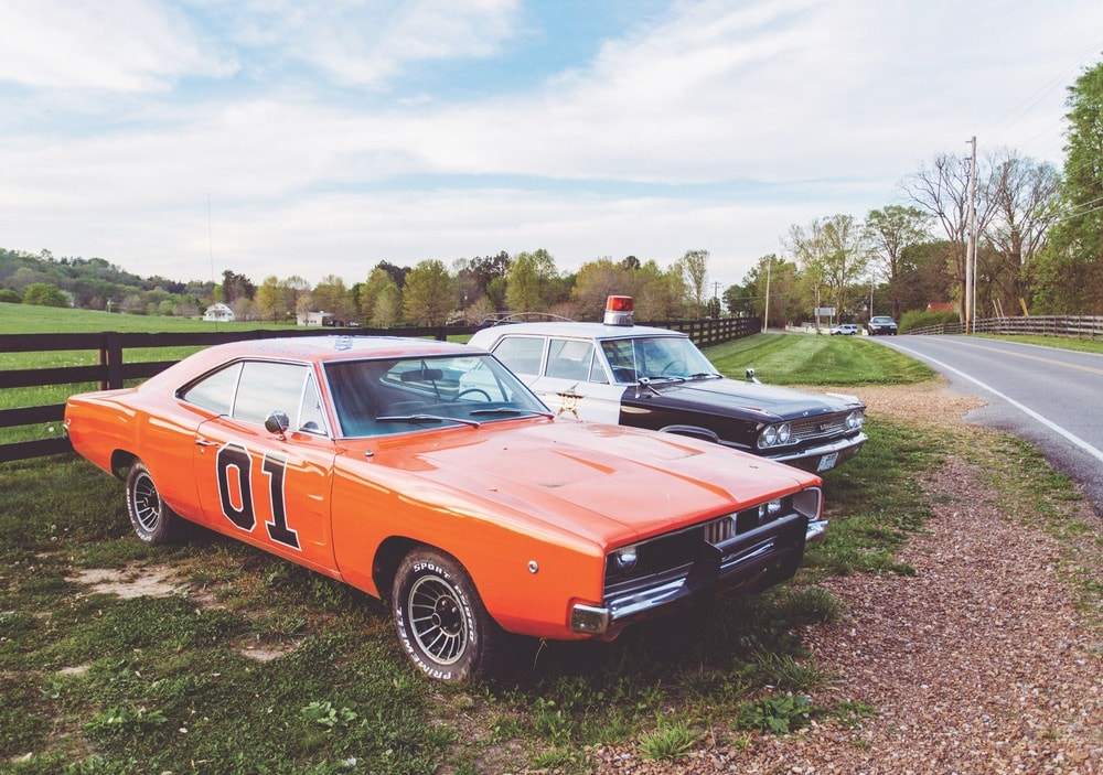 The General Lee from The Dukes of Hazzard and Deputy Barney Fife's police cruiser from The Andy Griffith Show greet visitors in Leiper's Fork. (John Schneider, who played Bo Duke, was even the grand marshal of the 2018 Leiper's Fork Christmas Parade.)