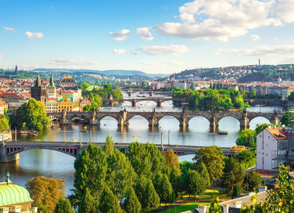 Row of bridges in Prague at summer day