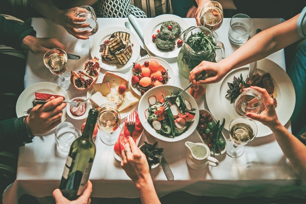 VIE Magazine, Cindy Garrard Column, Party dinner table, celebrating with friends of family served at home or in a restaurant