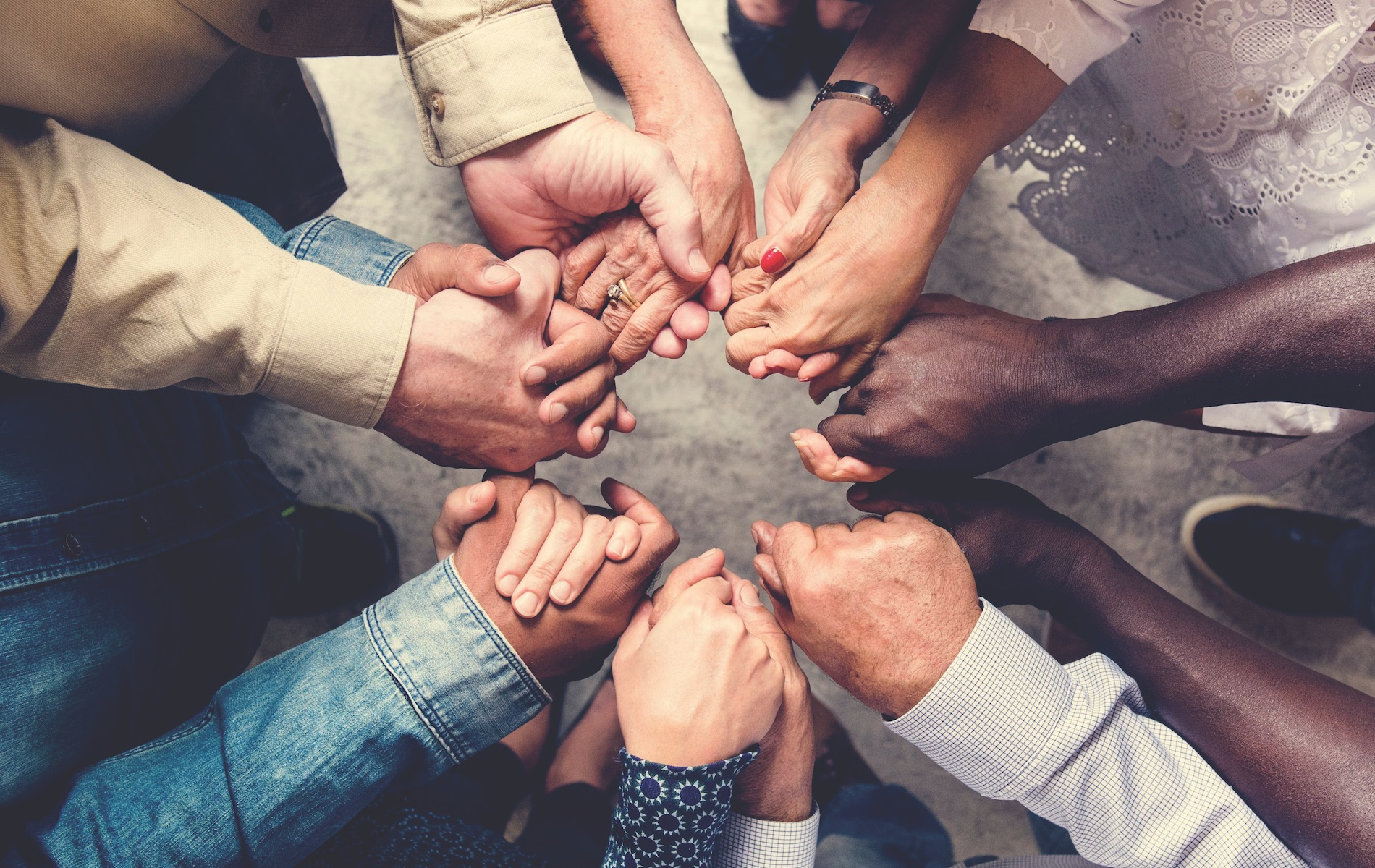 hands holding together diversity helping each other covid-19 response