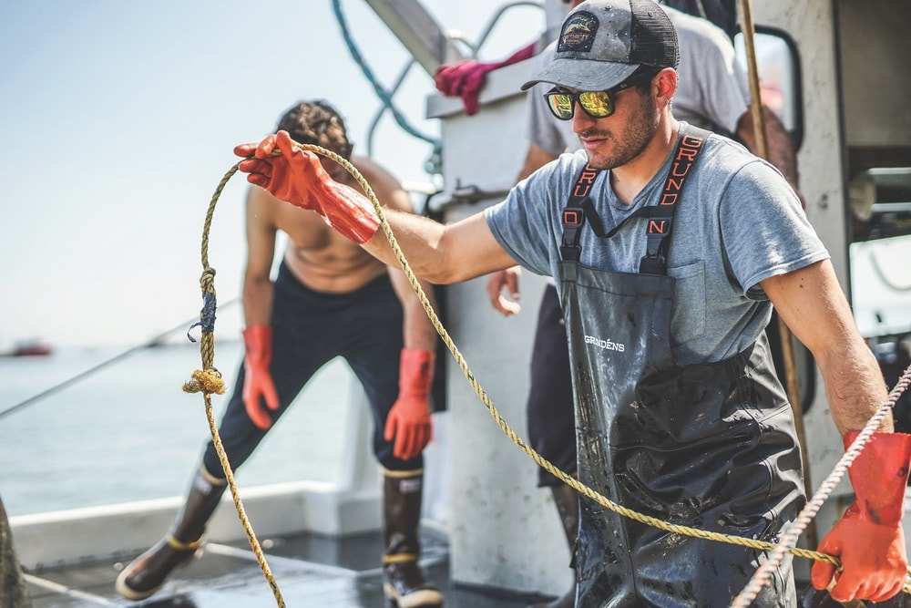 Commercial Fishing, Fisherman Rosario Aiello working hard in Bristol Bay
