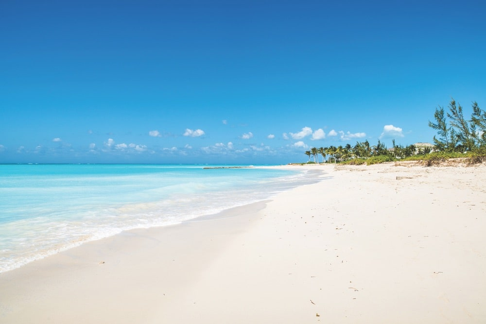 A scenic view of the beach in Turks and Caicos, another coastal paradise Suzanne Pollak once called home