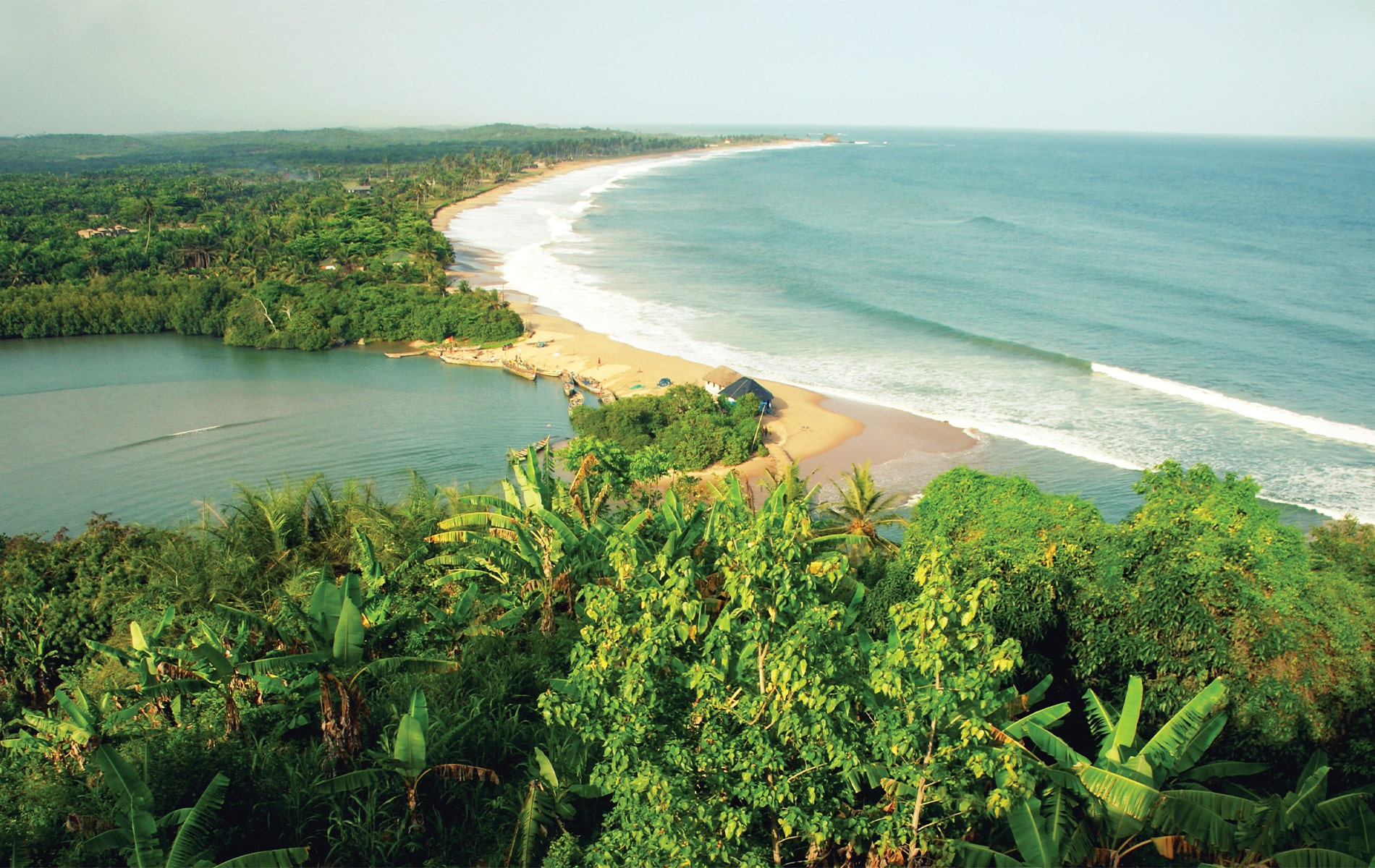The coastline of Ghana on the Gulf of Guinea, where writer Suzanne Pollak lived for a period during her childhood