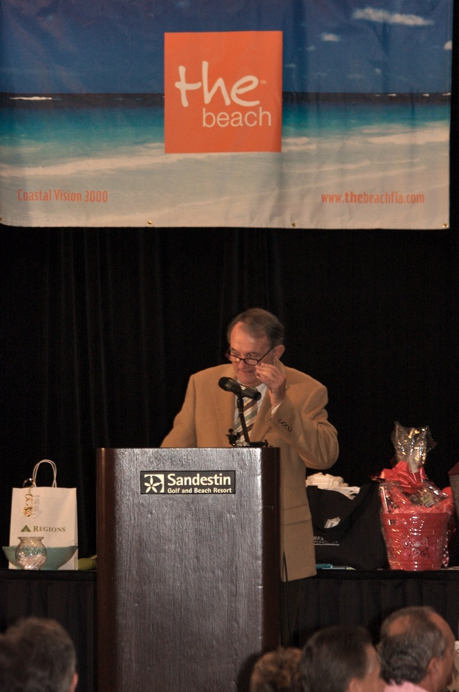 Man at podium at The Beach event