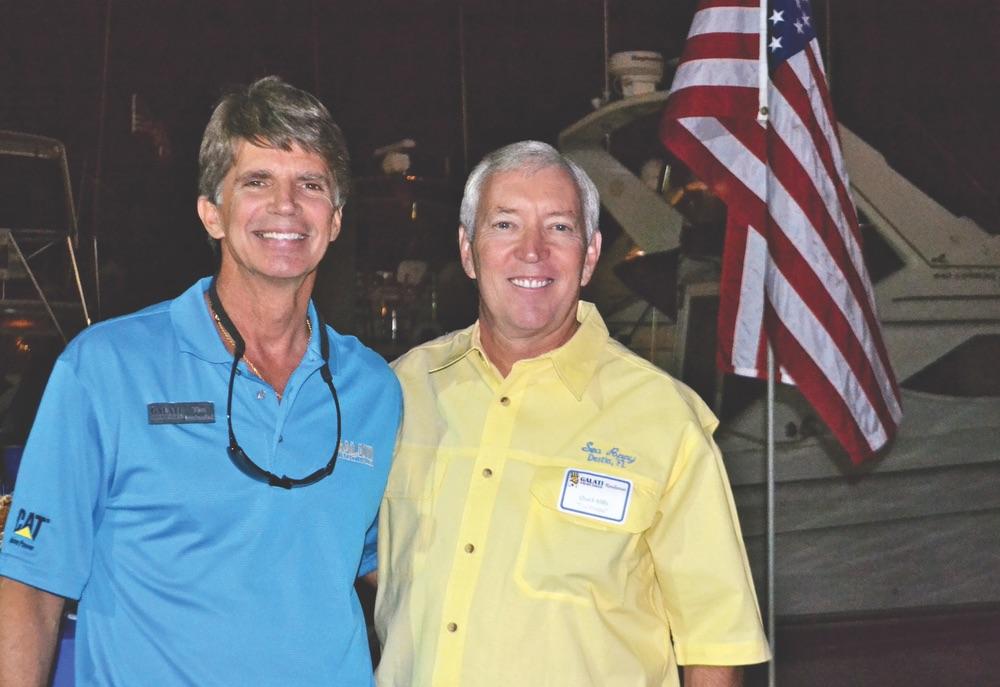 Galati Yacht Sales broker Tim Malambri with his client Chuck Mills
