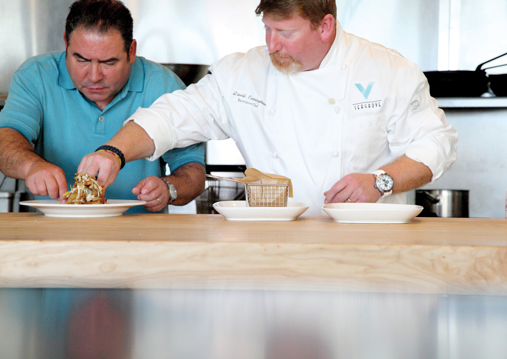 Chefs Emeril Lagasse and David Cunningham on the set of Emeril's Florida at V Seagrove restaurant. VIE Magazines in depth look at Emeril and Alden Lagasse, A Bountiful Life.