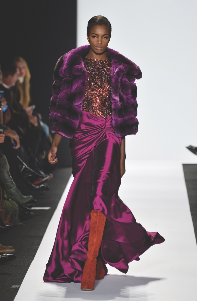 Vie Magazine Mercedes-Benz Fashion Week Fall 2014 New York City Model walks down runway purple dress by Dennis Basso