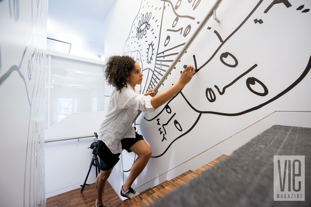 Martin works on a mural in a stairwell at Columbia University in New York, where she will be a 2015 fellow at the Brown Institute for Media Innovation. Photo by Roy Rochlin