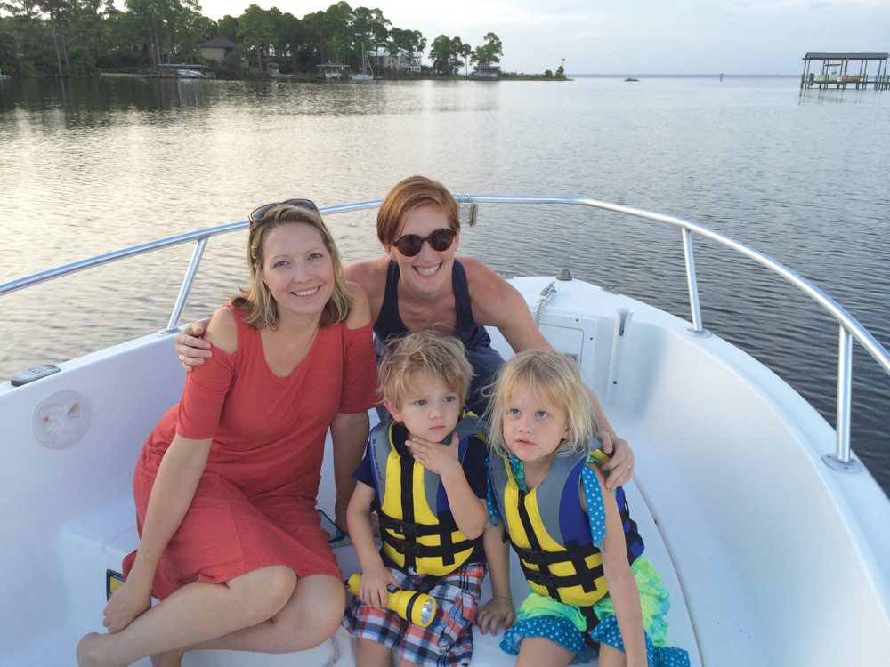 Family on a boat on the choctawhatchee bay