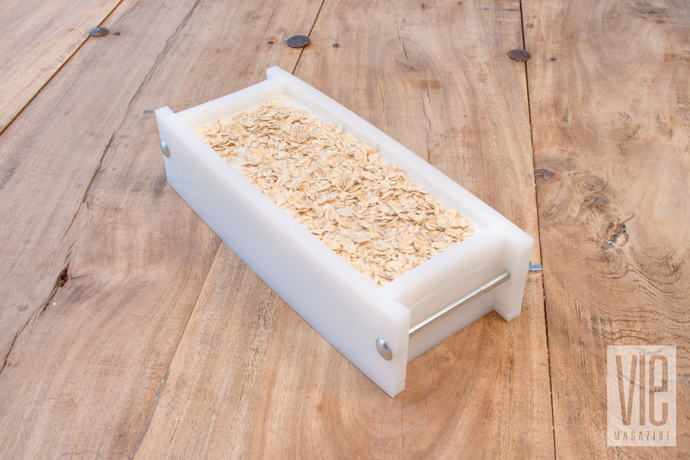 Soap hardened in mold with oat flakes