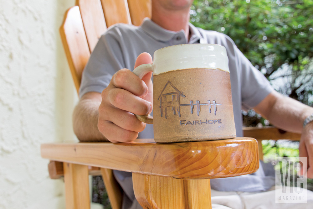 Man holding Fairhope Alabama coffee mug