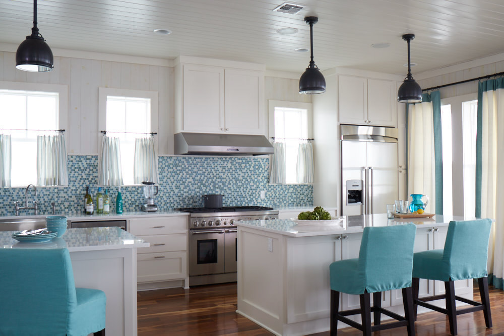 White kitchen with teal chairs