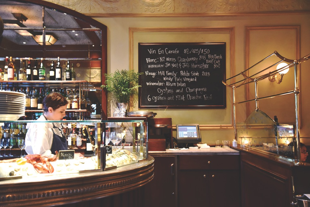 The raw bar and daily specials board at Bouchon